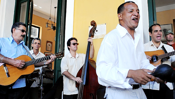 <p>Musicians play Cuban music in the style of the Buena Vista Social Club at the Taberna de La Muralla. Microbrewery patrons can listen to live music and look out at Plaza Vieja while drinking from a three-liter cylinder full of beer.  </p>