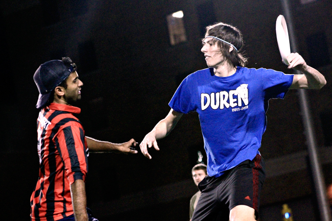 <p>Two members of the TUFF team hone their skills during practice at Clark Field on Wednesday night. </p>