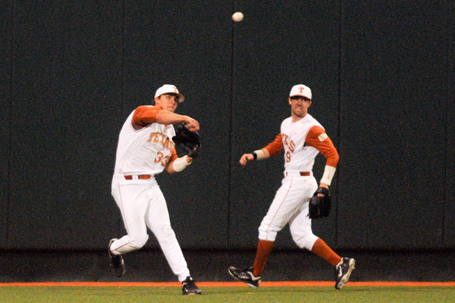 <p>Jonathan Walsh, 33, tries to throw a runner out in a recent game for Texas. Walsh carried UT offensively last weekend against Kansas State.</p>