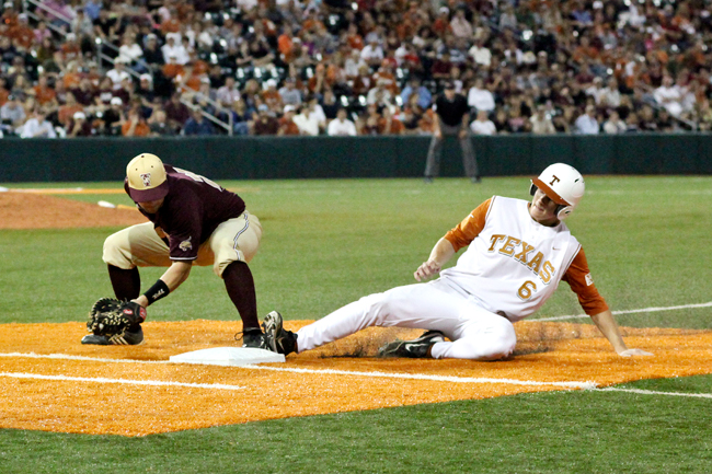 <p>Sophomore third baseman Erich Weiss slides safely back into first base during Texas' 6-1 win over Texas State last Tuesday. Weiss, a .348 hitter last season, went 7-for-15 in last weekend's three-game sweep of the Sooners, raising his batting average this year from .259 to .304.</p>