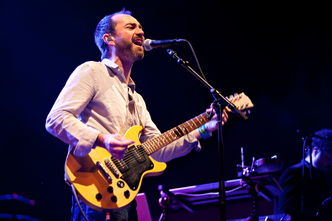 <p>The Shins frontman James Mercer sings and plays guitar at Auditorium Shores Thursday night. The band headlined the first day of the venue's three day free concert series.</p>
