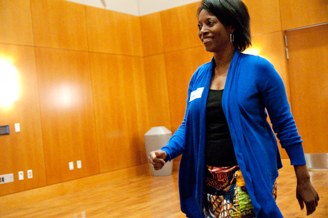 <p>Professor Dorie Goldman appraches the stage to accept her Tower Award Wednesday evening. Goldman was honored for her Ghana Maymester program, in which students travel overseas to perform community service.</p>