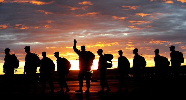 <p>A soldier waves to his family as the Montana Army National Guard 484th MP Company departs from Edwards Jet Center in Billings, Mont. on Tuesday. The unit is headed to Afghanistan, where they may be one of the last companies to serve as troops, as opposed to military advisers over the next 10 years. </p>