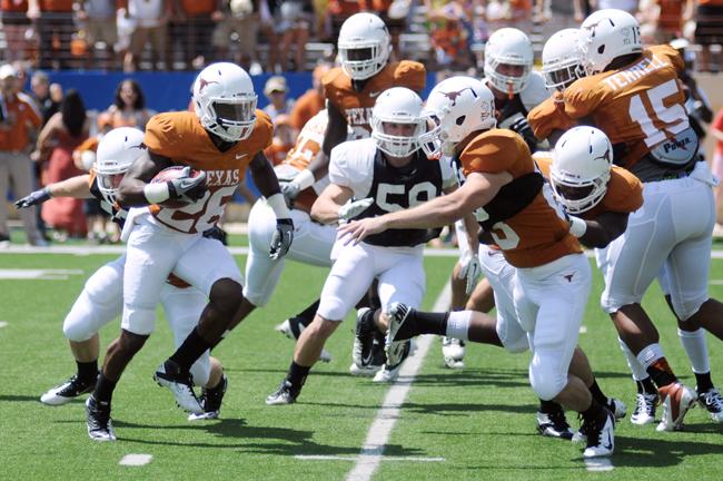LESSONS_2012-04-01_Orange_vs_White_Football_Zachary_Strain15958