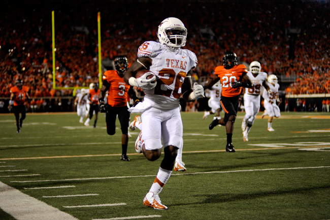 <p>Longhorn running back D.J. Monroe returns a kickoff for a touchdown during the first quarter of the game against the Oklahoma State Cowboys in Stillwater, Oklahoma.</p>