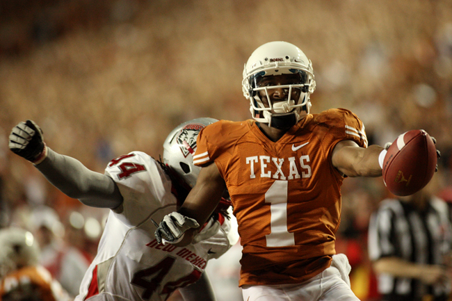 <p> Mike Davis scores a touchdown at the end of the first half against New Mexico. The Longhorns lead 17-0 at the half.</p>