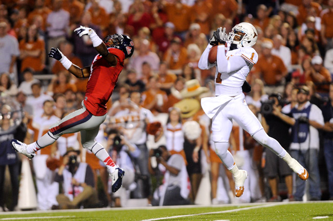 <p>Mike Davis catches the ball on Saturday night against Oklahoma State. In the second quarter of the game, Davis dropped a touchdown pass. On the final drive of the game, he caught a 32-yard pass that led to the game winning touchdown.</p>
