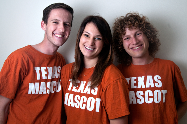 <p>From left to right, Evan Rowley, Caroline Carmer and Michael Graff are the faces behind UT mascot Hook' Em.</p>