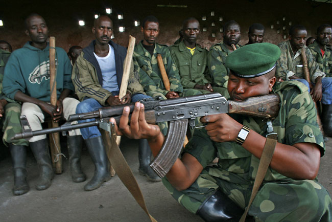 <p>In this file photo taken Oct. 23, 2012, M23 rebels conduct training exercises in Rumangabo, eastern Congo. The Rwandan-backed rebel group advanced to within 4 kilometers of Goma on Sunday.</p>