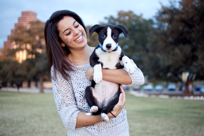 <p>Psychology junior Maria Cardenas, a volunteer for Austin Pets Alive!, adopted her dog Dash after fostering and treating the dog for parvovirus with medicine provided by the organization. Austin Pets Alive! aims to rescue animals at risk of being euthanized but a lack of city funding may affect how many animals can be admitted.</p>