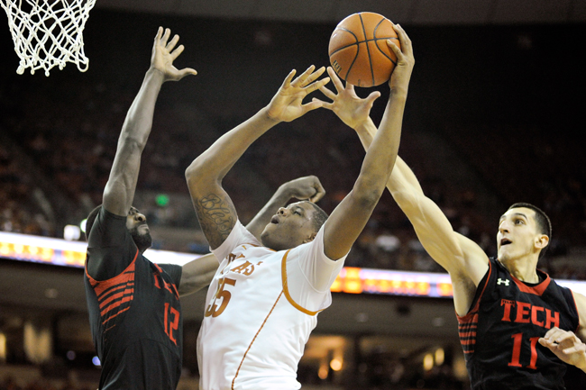 <p>Texas center Cameron Ridley attempts a shot in the Longhorns' 73-57 victory over Texas Tech where they broke a five-game losing streak and recorded their first conference win of the season. Ridley scored six points, grabbed 10 rebounds and had three blocks.</p>