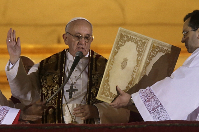 <p>Pope Francis speaks from the central balcony of St. Peter's Basilica at the Vatican, Wednesday, March 13, 2013. Cardinal Jorge Bergoglio, who chose the name of Francis, is the 266th pontiff of the Roman Catholic Church.</p>