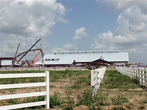 <p>This photo provided by KBTX-TV shows damage to theTexasA&M University equestrian center on Saturday, June 22, 2013 near College Station,Texas. A portion of the equestrian center under construction has collapsed.</p>