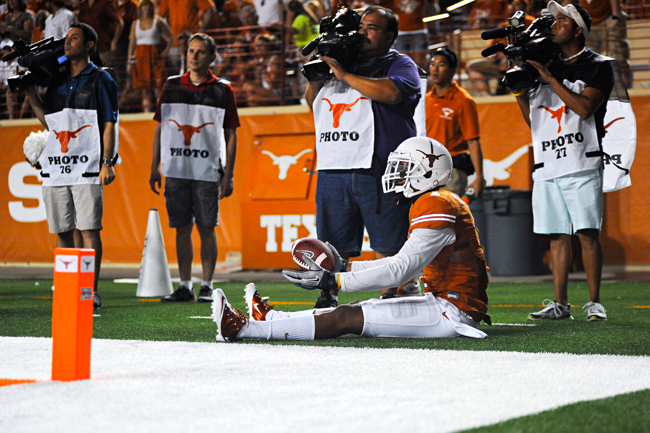 <p>Mike Davis sits down near the corner of the end zone. The wide receiver leads the Longhorns with 20 catches this year but is part of a senior class that is in danger of becoming the first in 10 years to not reach a BCS bowl. </p>