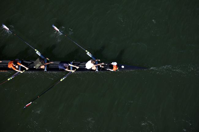 <p>Texas Crew rows on Town Lake</p>