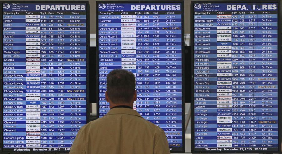 <p>On the busiest travel day of the year, a passenger checks the departures board in a terminal at Denver International Airport, Wednesday, Nov. 27, 2013. More than 43 million people are to travel over the long holiday weekend, according to AAA.</p>