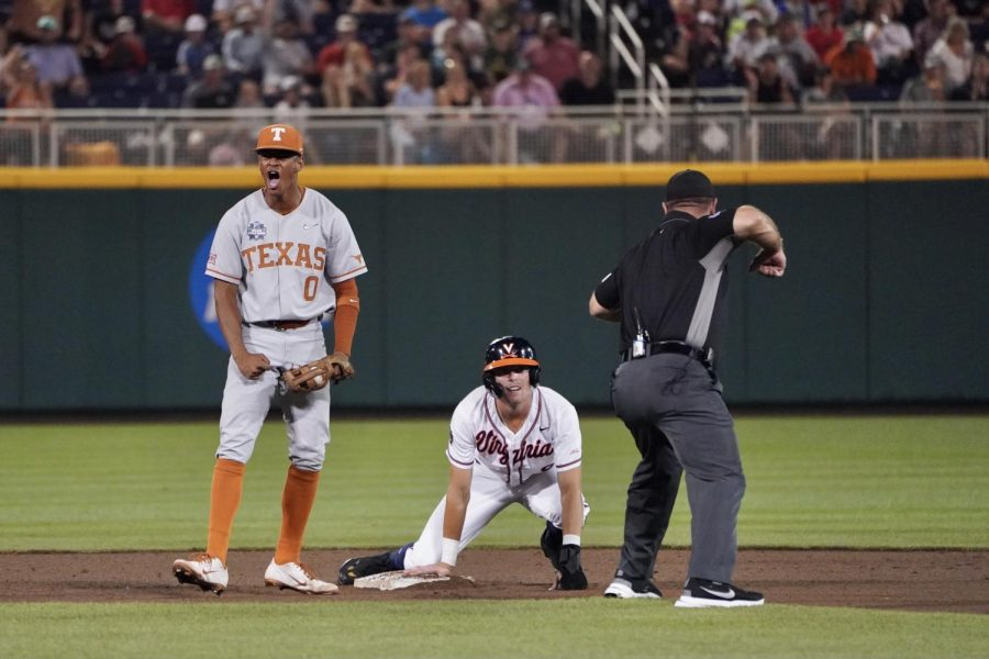 Longhorn+batters+come+up+big+late%2C+defeat+Virginia+6-2+to+stay+alive